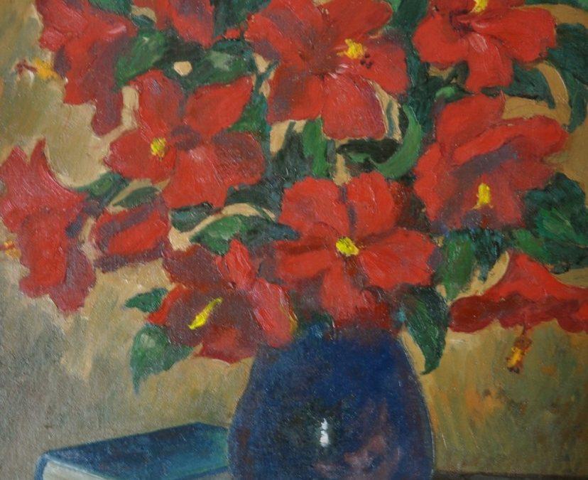 Red Hibiscus in blue vase